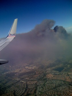 Smoke from southern California wildfires as seen from plane during approach to Anaheim
